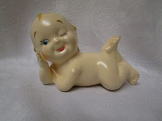 Vintage Rare Germany Kewpie Porcelain Doll.  Laying On Side Winking.