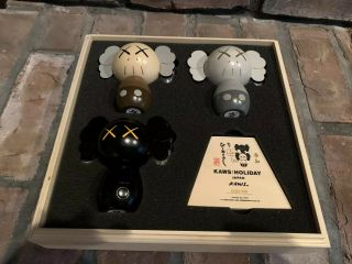 Kaws: Holiday Japan Limited Wood Kokeshi Doll Set (set Of 3) In Hand.