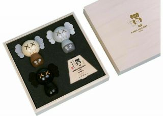 Kaws Holiday Japan Limited Kokeshi Doll Set (set Of 3) Order Confirmed