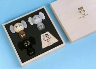 Kaws:holiday Japan Limited Kokeshi Doll Set (set Of 3) In Hand