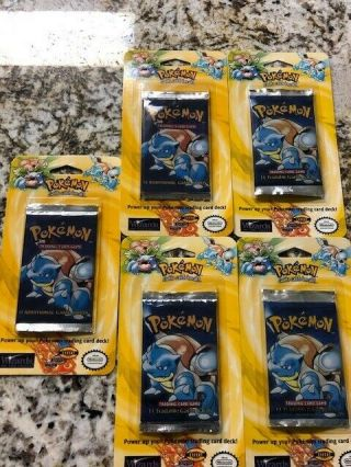 12 Rare Pokemon Packs.  (9) Wizards Of The Coast & Neo Genisis