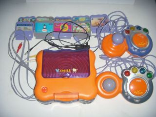 V Tech V Smile Tv Learning System With 2 Controllers,  Supply Cord,  And 10 Games